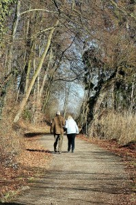 Older couple walking down a path.
